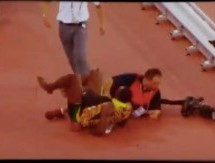 Video: Chinese Cameraman falls on Usain Bolt after Men's 200m Final