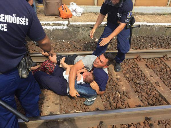Desperate Father Drags His Wife & Child onto Train Tracks in Hungary