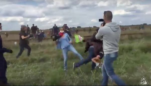 Hungarian Camerawoman Trips Refugee With Child as He Runs from Police