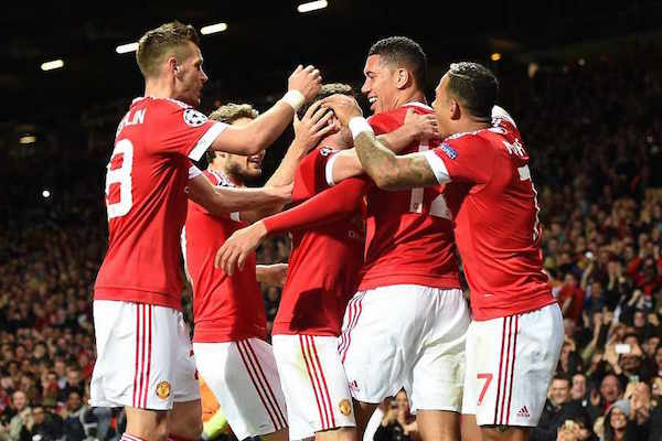 Manchester United's Chris Smalling (second right) celebrates with his team-mates after scoring