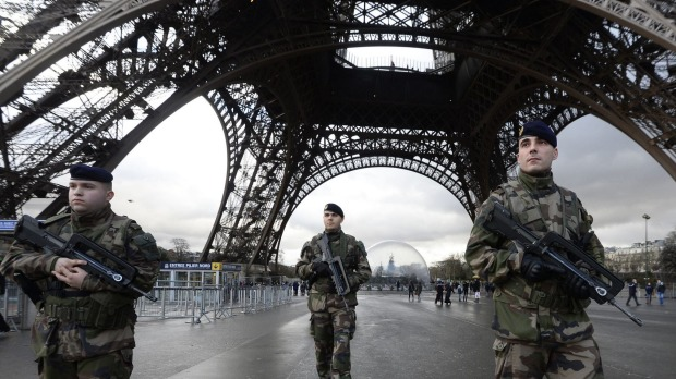 French soldiers guard the Eiffel Tower in Paris