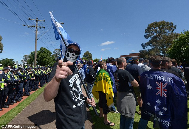 Members of the anti-Islam group Reclaim Australia protest over plans for a mosque in Melton Read more: http://www.dailymail.co.uk/news/article-3329909/Adolf-Hitler-impersonator-spotted-hanging-Reclaim-Australia-s-anti-Islam-protest-Brisbane.html#ixzz3sJwnRIKo Follow us: @MailOnline on Twitter | DailyMail on Facebook