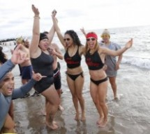 Video: People Plunge Into Icy Water at New York Beach