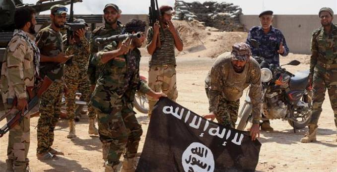 ISIS fighters displaying their emblem and determination to fight