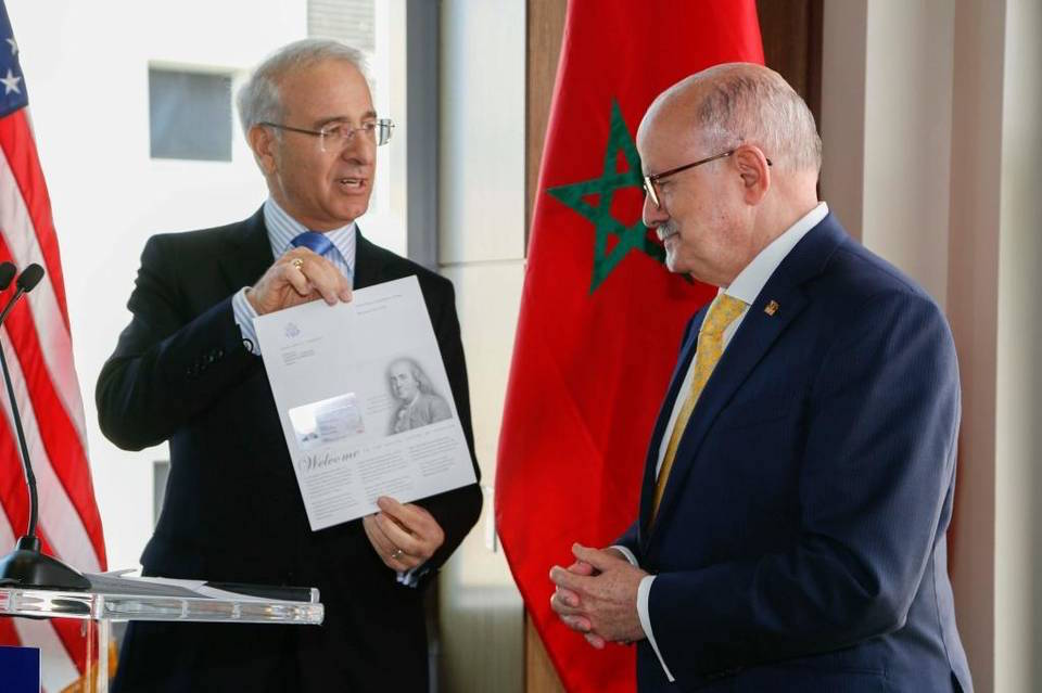 Rachad Bouhlal, ambassador of the Kingdom of Morocco to the United States, presents a proclamation to Miami Dade College President Eduardo Padrón