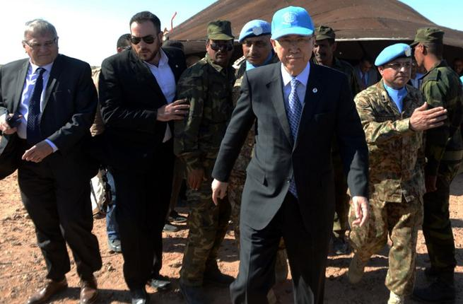 UN Secretary General Ban Ki-Moon leaves a meeting about Western Sahara in arch 5, 2016, near a UN base in Bir-Lahlou, Algeria. (AFP/Farouk Batiche)