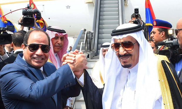 Abdel Fatah al-Sisi, left, shakes the hand of King Salman of Saudi Arabia after signing an agreement over the islands. Photograph: Sherif Abdel Minoem/AP