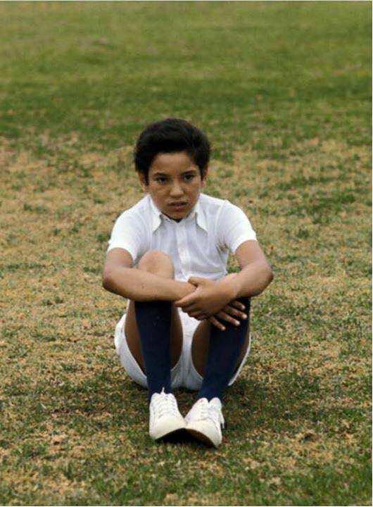 KIng Mohammed VI as a boy having a rest after a football match