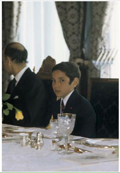 KIng Mohammed VI as a boy in official dress at an official dinner