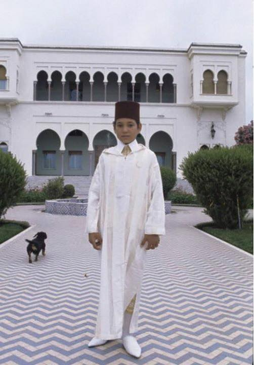 KIng Mohammed VI as a boy with Moroccan jellaba and a fez