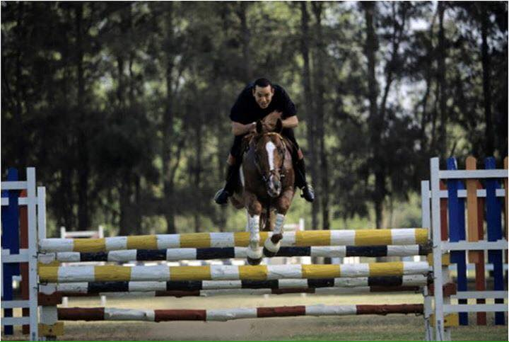 KIng Mohammed VI as a grown up addult doing horse jumping