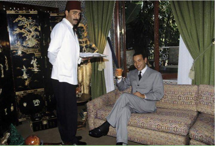 KIng Mohammed VI as a grown up addult raising a glass of juice
