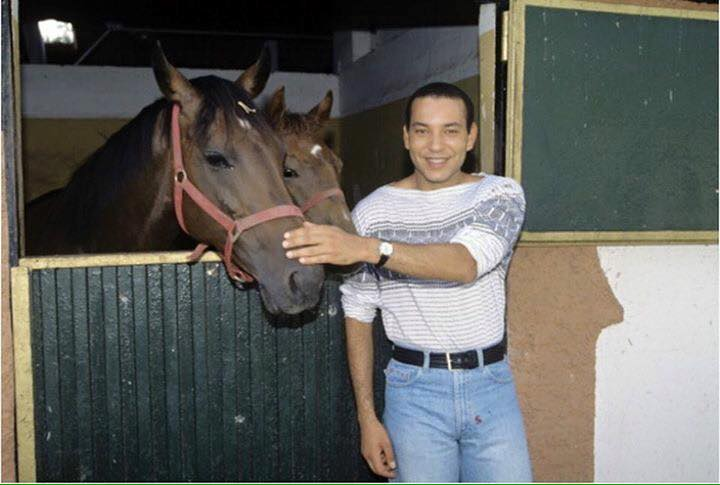KIng Mohammed VI as a grown up addult with his horse in the horse barn