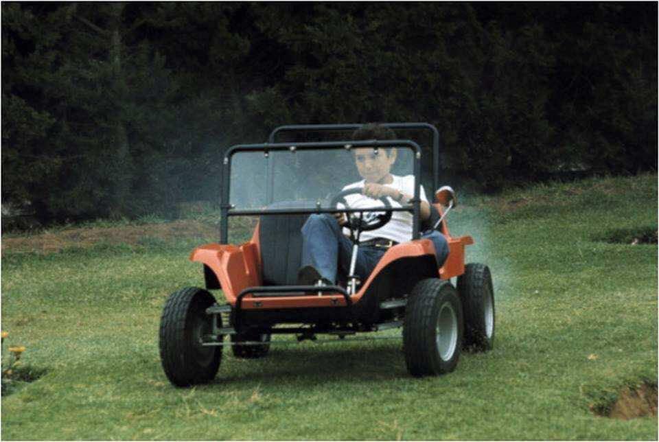 KIng Mohammed VI when he was little boy riding a fourwheeler