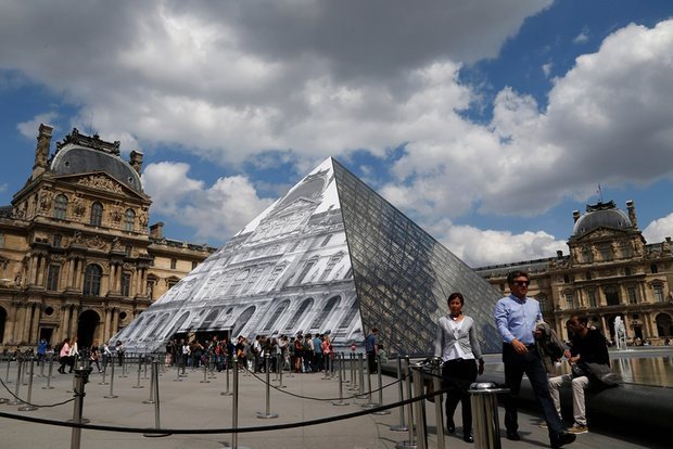 Beat that Bansky ... the Louvre facade revealed. Photograph: Pascal Rossignol/Reuters