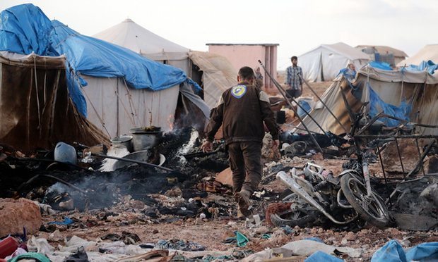 The aftermath of the bombing of the al-Kammouneh refugee camp in Syria. Photograph: Anadolu Agency/Getty Images