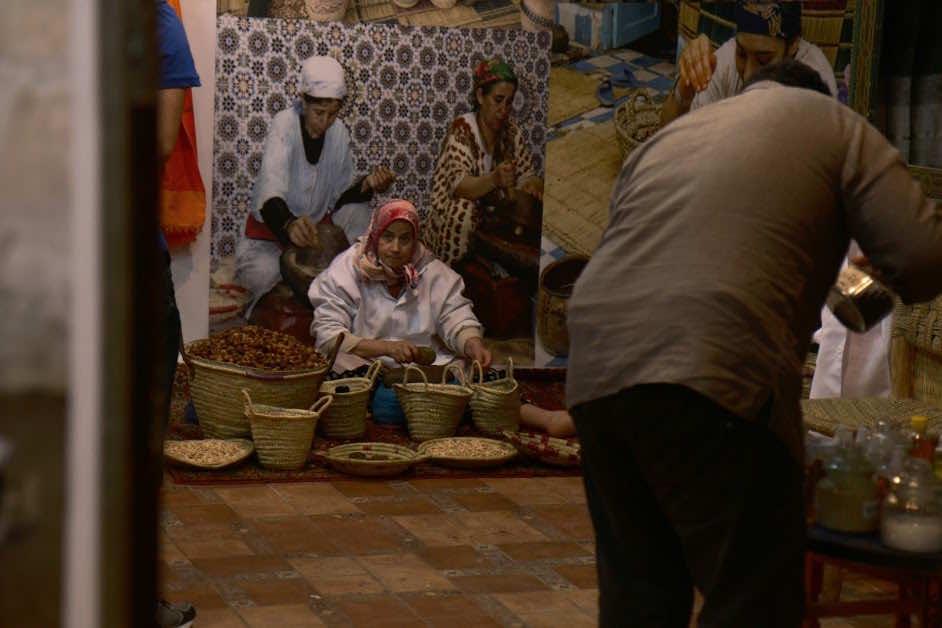 Moroccan Woman working on Argan oil in a co-op in Fez medina