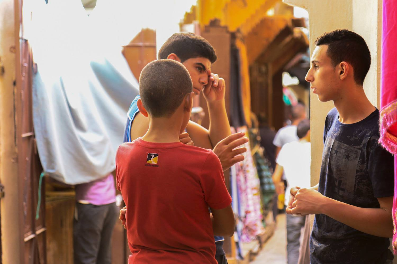 Moroccans in Fez Medina. Attarine Street