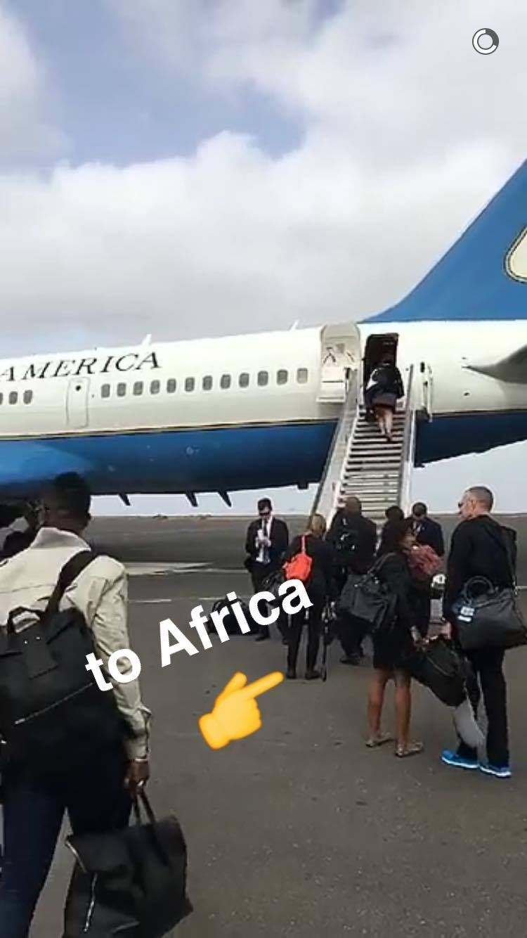 Mrs. Obama setting off from America on Air Force One.