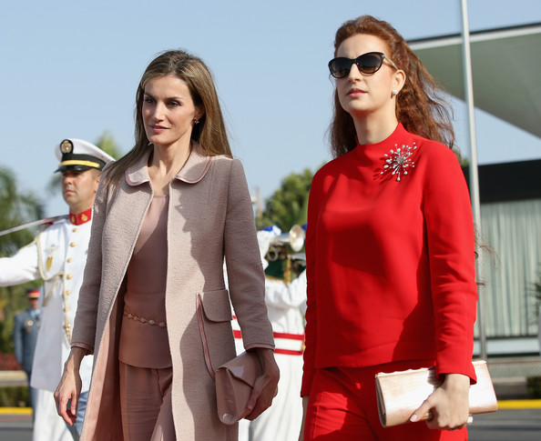Queen Letizia of Spain and Princess Lalla Salma of Morocco walk down the red carpet at Rabat Airport on July 15, 2014 in Rabat, Morocco