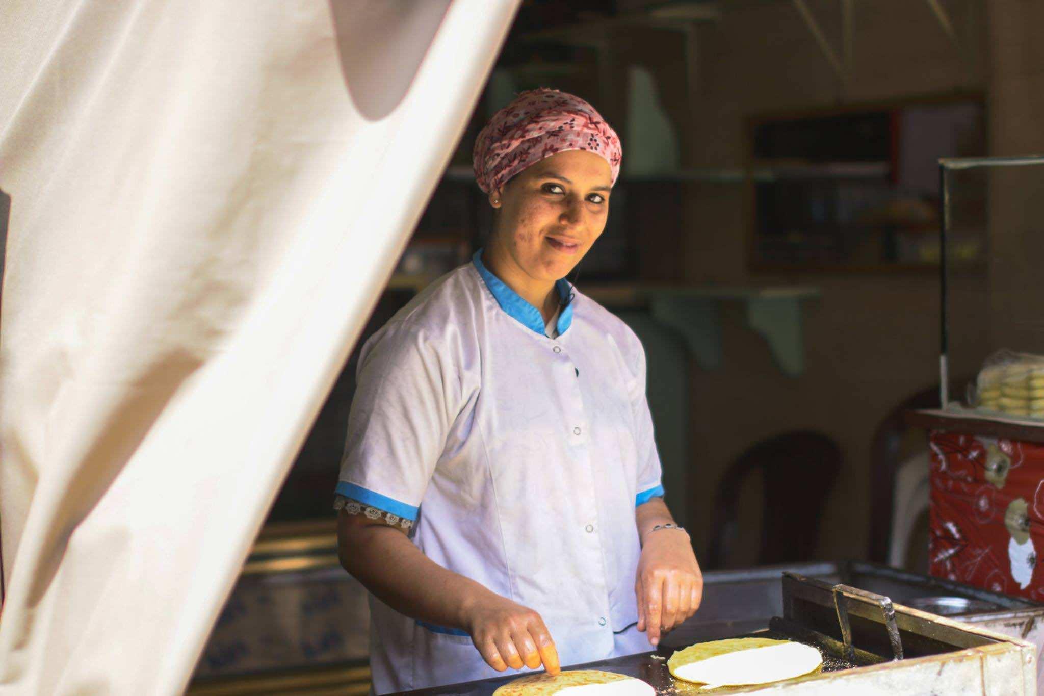 Inside the Walls of Old Medinas- woman selling pancakes in Rabat