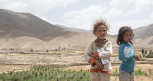 Two Moroccan girls in Imlchil. Remote Berber Villages Struggle with Infrastructure and Poverty