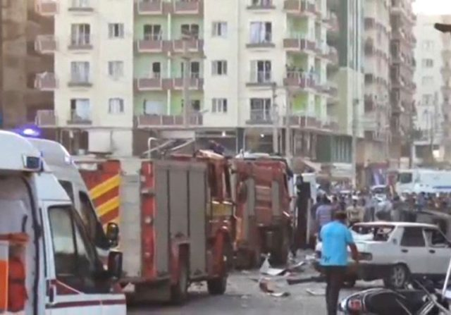 A still image taken from a video footage shows emergency vehicles at the scene of a bomb blast in Kiziltepe, Turkey. (photo credit:REUTERS)