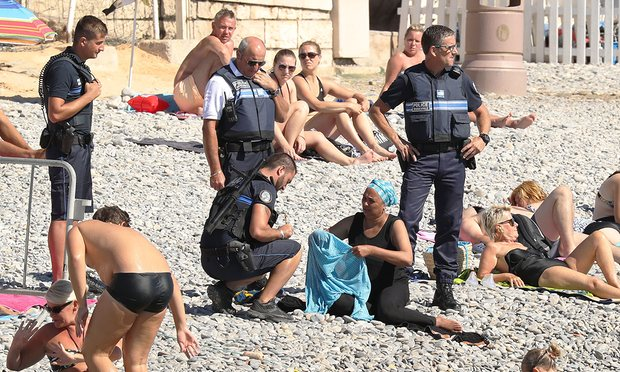 French Police Force Muslim Woman to Remove Her Swimwear on the Beach....