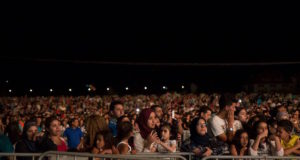 Moroccan fans cheering for musicians at the Festival of Ifrane