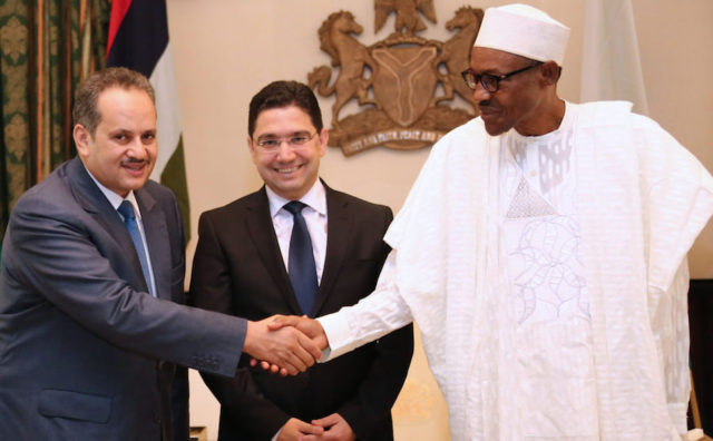 President Muhammadu Buhari with Nasser Bourita. Photo by SUNDAY AGHAEZE