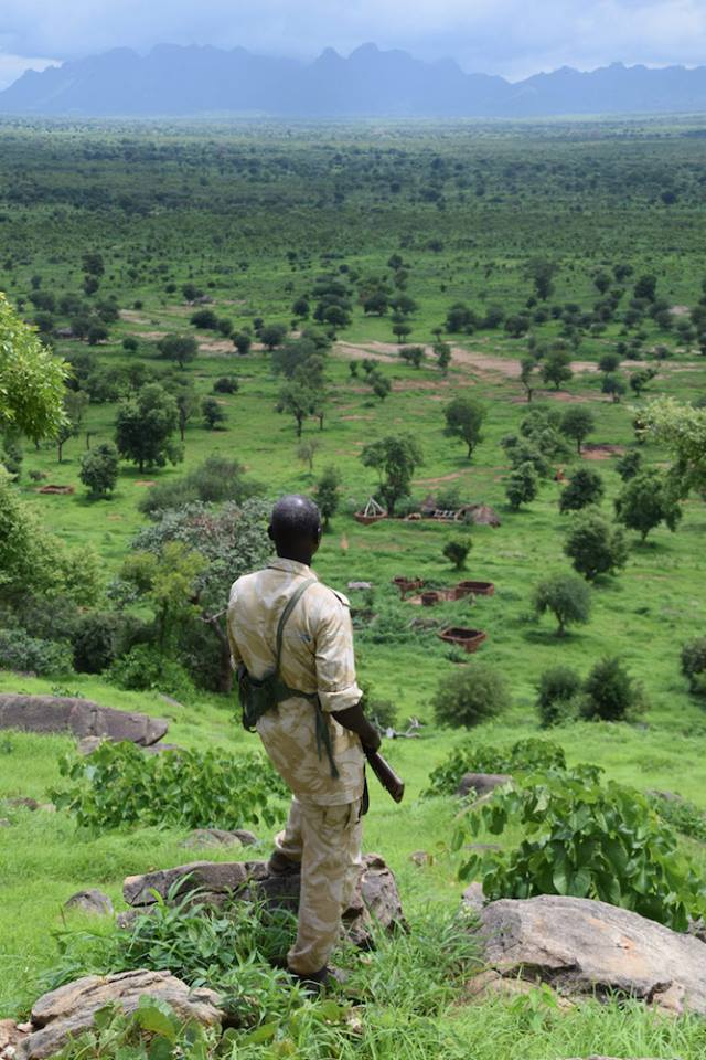 Soldier looks down on the frontline area in South Kordofan