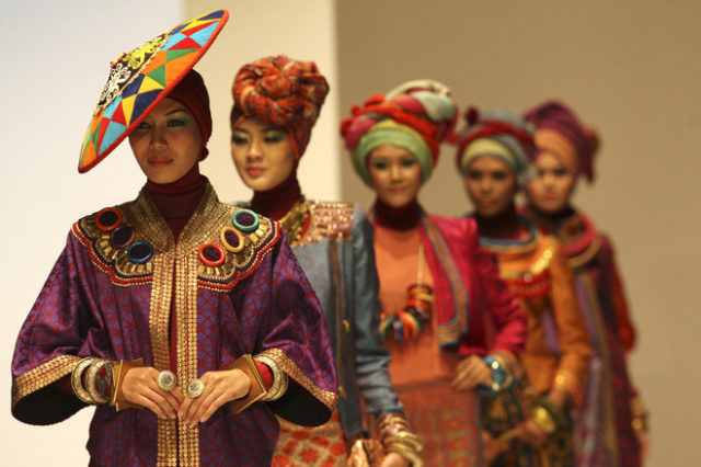 Models present creations of designer Dian Pelangi during the Indonesia Fashion Week in Jakarta in February