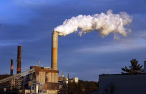 FILE - In this Jan. 20, 2015 file photo, a plume of steam billows from the coal-fired Merrimack Station in Bow, N.H. If the nation doesn't do more, the U.S. probably won't quite meet the dramatic heat-trapping gas reduction goal it promised in last year's Paris agreement to battle climate change, according to a new study. (AP Photo/Jim Cole, File)