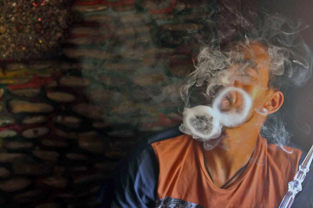 Moroccan man Smoking Hookah. Photo by Emily Rathmanner