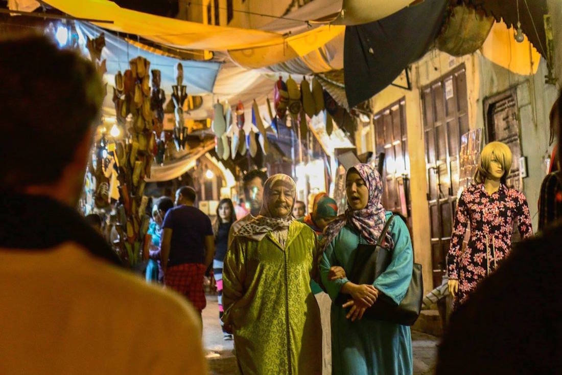 Residents walk in the old Medina of Fez. Photo by Morocco World News
