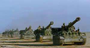 U.S. Army howitzers in Saudi Arabia head toward the Kuwait border in 1991. Peter Dejong/AP