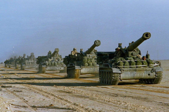 U.S. Army howitzers in Saudi Arabia head toward the Kuwait border in 1991. Peter Dejong/AP