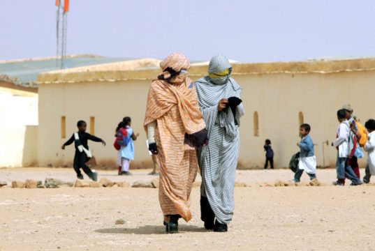 Refugees from Western Sahara walk through a school in a refugee camp in the Tindouf reigon of south-western Algeria on October 18, 2005 (AFP Photo/Fayez Nureldine)
