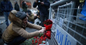 A young woman leaves flowers outside the Reina nightclub in Istanbul which was attacked by a gunman during new year celbrations on January 1, 2017. Emrah Gurel / AP Photo