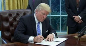 Trump Signs Order to Withdraw from Trans-Pacific Partnership