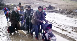 Syrian Family Drags Luggage & Baby Stroller Through Snow to Reach Canada