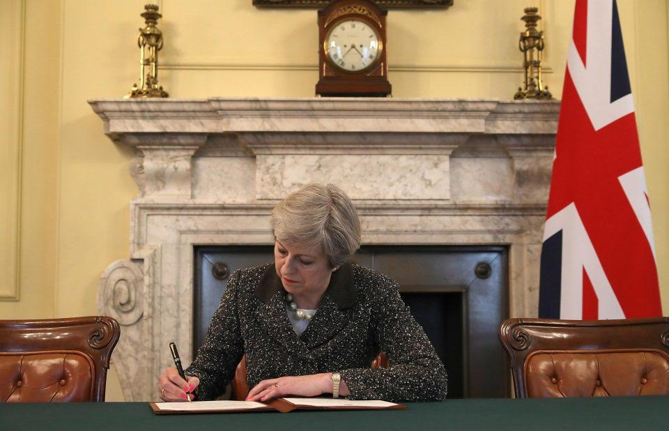 British PM Theresa signs letter for Brexit with calls for UK unity