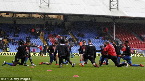 Crystal Palace players warm up ahead of the Barclays Premier League clash