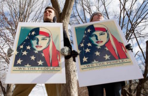 Demonstrators gather near the White House on March 11, 2017, to protest President Trump's travel ban. (Tasos Katopodis/AFP/Getty Images