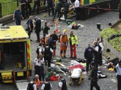 Emergency services attend to injured people after an incident outside the Palace of Westminster