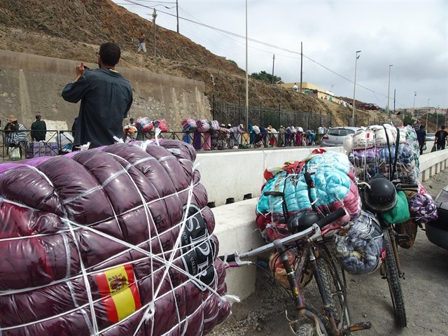 Porters stand in line to cross Ceuta Borders