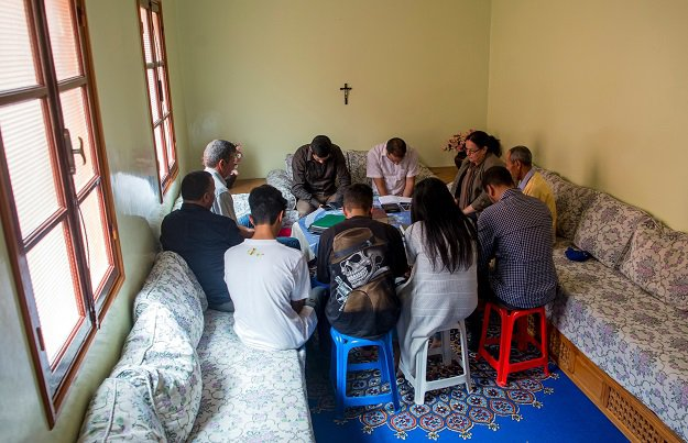 Moroccan Christian converts attend prayers at a house in Ait Melloul near Agadir on April 22, 2017. PHOTO: AFP