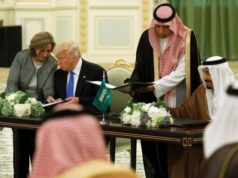 Saudi Arabia's King Salman bin Abdulaziz Al Saud and U.S. President Donald Trump sign a joint security agreement at the Royal Court in Riyadh