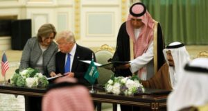 Saudi Arabia's King Salman bin Abdulaziz Al Saud and U.S. President Donald Trump sign a joint security agreement at the Royal Court in Riyadh