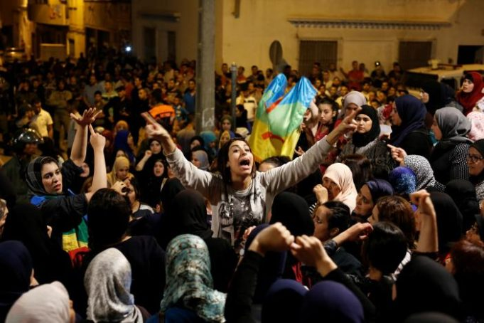 Women shout during a protest against official abuses and corruption in the town of Al-Hoceima